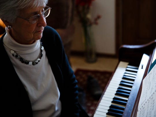 Beverly McCartney, 80, of Fort Dodge, sits and plays at the piano on Friday, Jan. 20, 2017, in Fort Dodge. McCartney's husband John was killed by drunken driver.