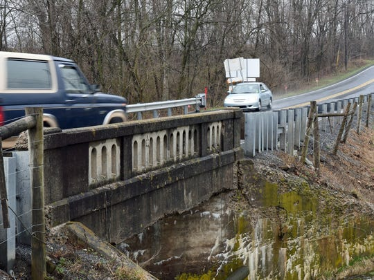 Vehicles travel over a bridge at Lehman run on Tuesday, March 28, 2017. The bridge on Upper Strasburg Road (Pa. 533) just west of Pleasant Hall will be closed until the end of August starting Tuesday, April 4.