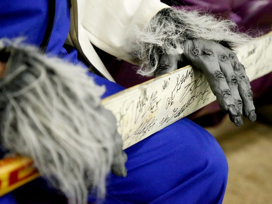 Sporting his Dr. Jackal gloves, Paul DiPietro holds a hockey stick signed by some of the first Jackals on Wednesday.