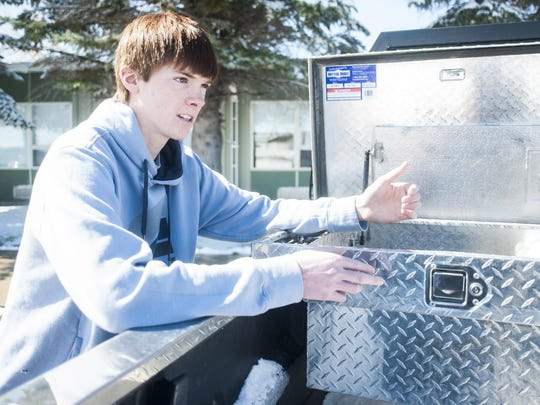 """Hayden Heilig, a senior at Moore High School, opens his truck's tool box to show where his hydrogen generator will go after he presents it at the National INTEL Science Fair in Los Angeles, Calif. """"When I first started it there was this thought in my mind that it wasn't going to work. I never expected it to go as far as it has. Seeing it actually produce hydrogen, I was blown away,"""" Heilig said."""