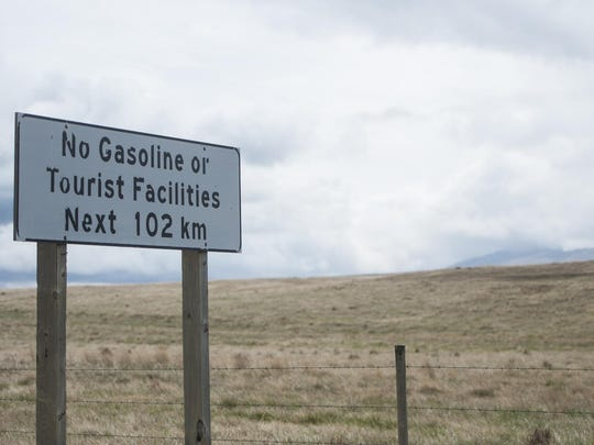 A sign notes area remoteness near the West Butte of
