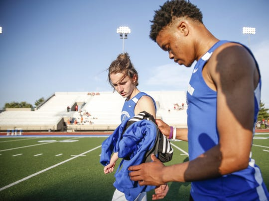 "Hamilton Southeastern hurdler John Night brings Noah Malone his shoes and clothes after a race. Malone  rarely goes anywhere at a track meet alone.  Teammates accompany him, warm up with him, check in before races with him. Malone said they stand ""right by me."""