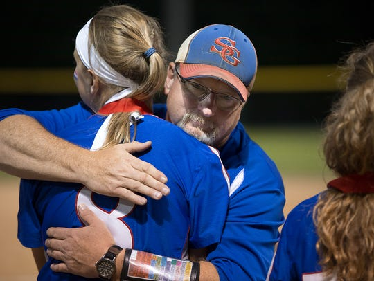 Spring Grove's Hailey Kessinger gets a hug from head