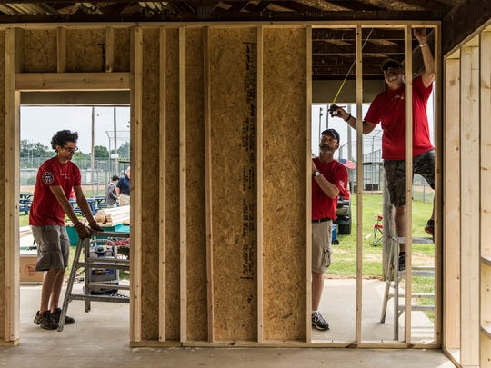 Lowe's employees Brandon Agnew (left to right), Ronnie