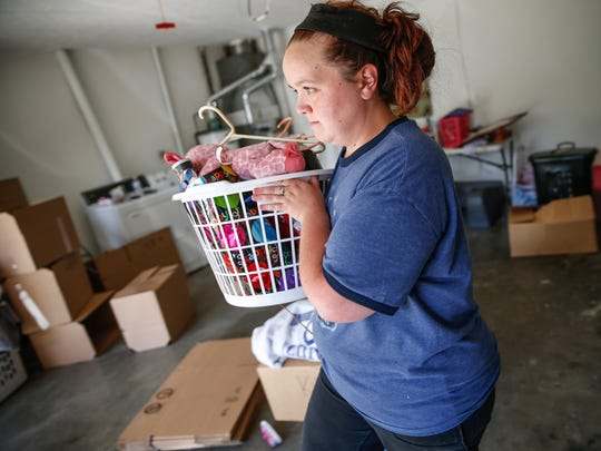"Ashley Glenn packs up the home she thought she was purchasing from Chart Properties on Wednesday, June 7, 2017. ""We were told we were going to be owning this house,"" said Glenn. ""We made plans of adding on, changing it. It's sickening that you think you're going into this and you'll be a homeowner."""