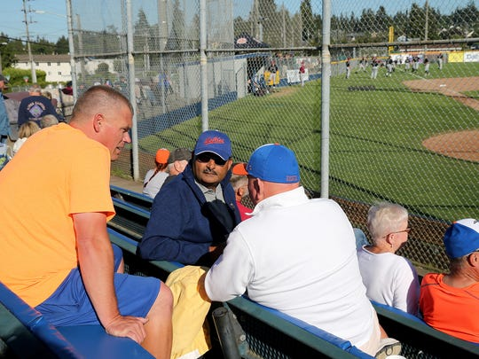 Port Angeles Lefties owner Matt Acker (left) mingles with fans before a July 14 game against the Corvallis Knights at Civic Field in Port Angeles. Acker moved his West Coast League franchise from Bremerton to Port Angeles after the 2016 season.