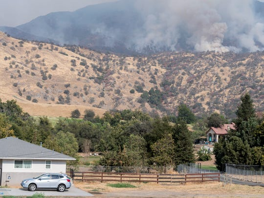 The Pier Fire continues to burn above Springville on
