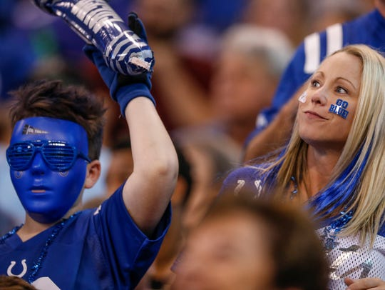 Indianapolis Colts fans cheer after a touchdown run