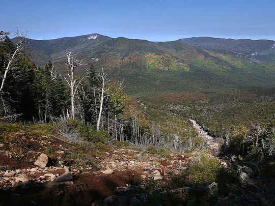 Looking out over the High Peaks region from the top of Bennies Brook Slide on Lower Wolf Jaw in the High Peaks of the Adirondacks, Tuesday Sept. 12, 2017.