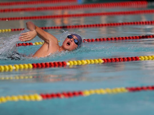 Redding Christian's Daniel Snider competes in the men's  200 yard freestyle Wednesday at West Valley High School.