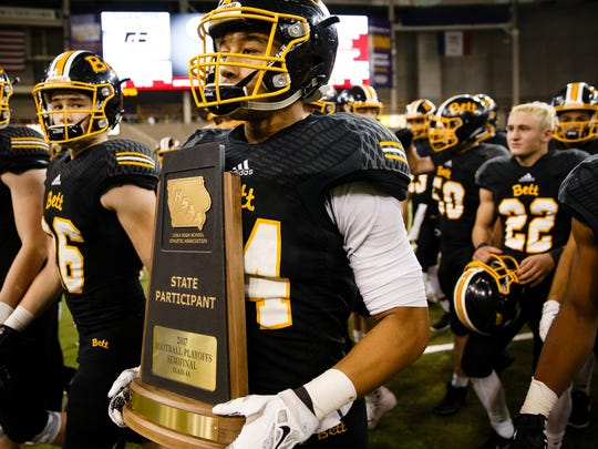 Bettendorf walks off the field with a state football semifinalist trophy in 2017 after losing to Iowa City West, 23-0, at the UNI-Dome in Cedar Falls.
