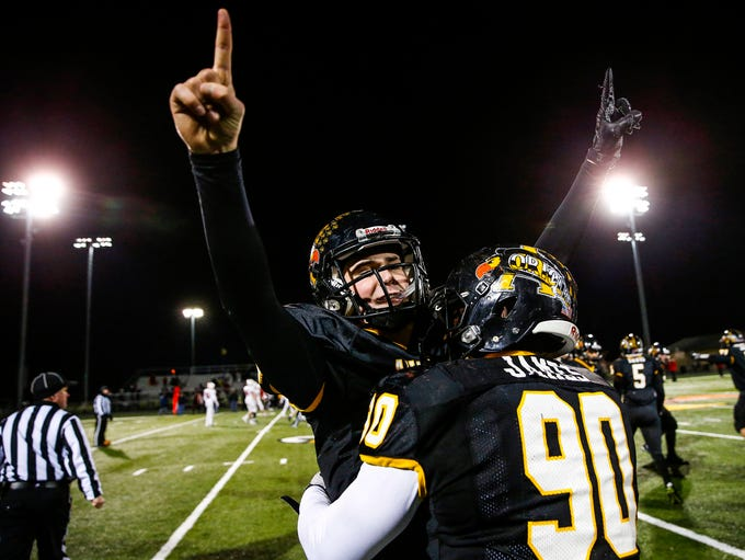 Avon Orioles' Cameron Misner (15) celebrates with teammate