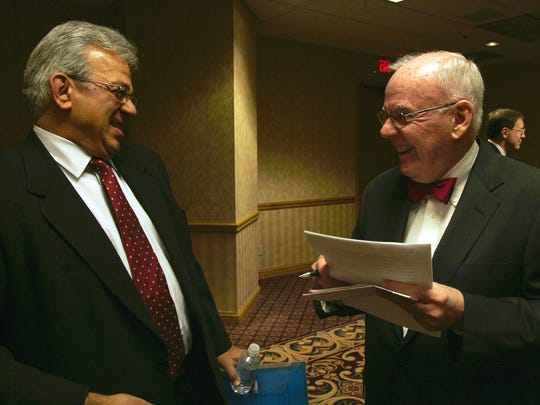 Suku Radia shares a laugh with Michael Gartner before