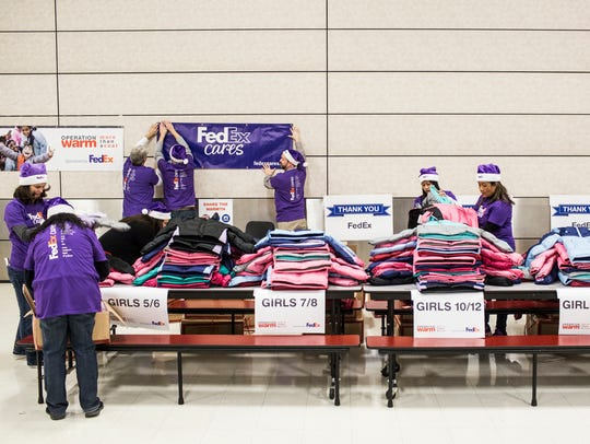 December 13, 2017 - FedEx volunteers prepare to help
