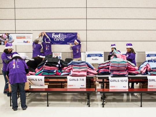 December 13, 2017 - FedEx volunteers prepare to help