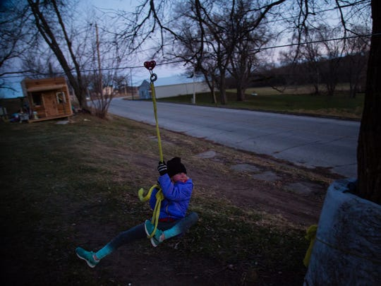 The lack of kids means no playground or other activities in town for Sadi Magnuson, 10, and her three sisters. Instead, their grandfather, Daryl Magnuson whom they live with, built them their own playground at his home on Wednesday, Dec. 6, 2017, in Carbon.