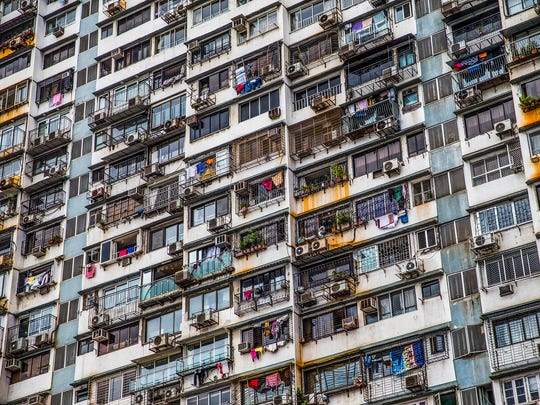 An apartment complex sits overlooking a highway in Mumbai, India, on Thursday, June 29, 2017. Mumbai, the most populous city in India and fourth most populous city in the world, had a metro population of nearly 20.7 million people in 2016.