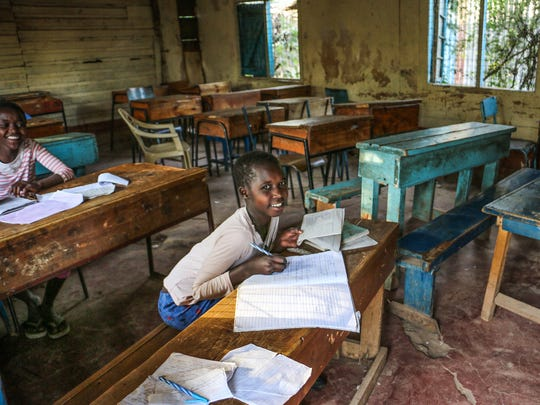 Girls study in a classroom at a shelter for children considered at risk of commercial sexual exploitation near Nairobi, Kenya.