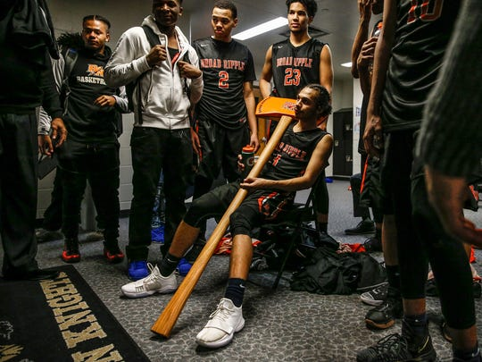 Broad Ripple Rockets' Maurice Trammel (3) hangs on to the Battle Axe after their win against rivals the Arlington Golden Knights 52-51 at Arlington High School on Friday, Feb. 9, 2018.