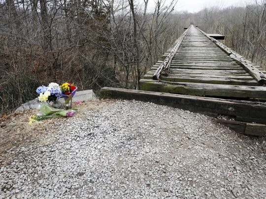 Flowers sit next to Monon High Bridge, east of Delphi, in memory of Liberty German and Abigail Williams.