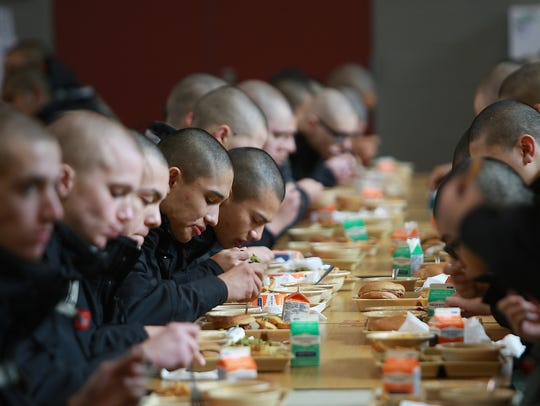 Washington Youth Academy cadets eat their lunch on Thursday.