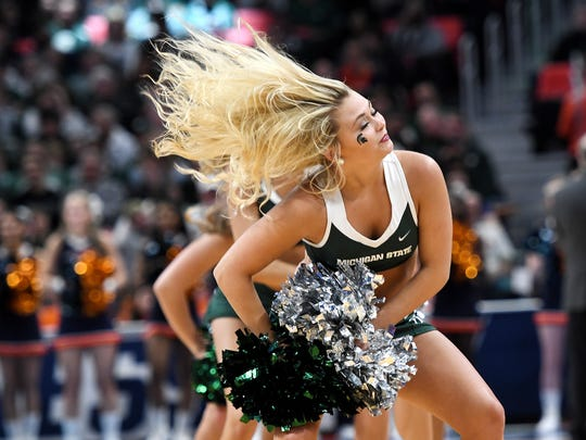 Michigan State cheerleaders perform during a timeout