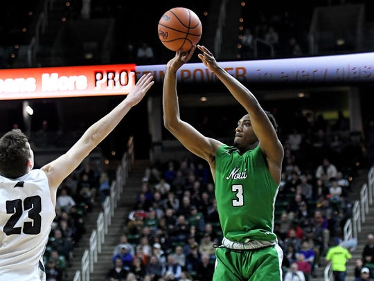 Novi's Jiovanni Miles, right, shoots as Holland West