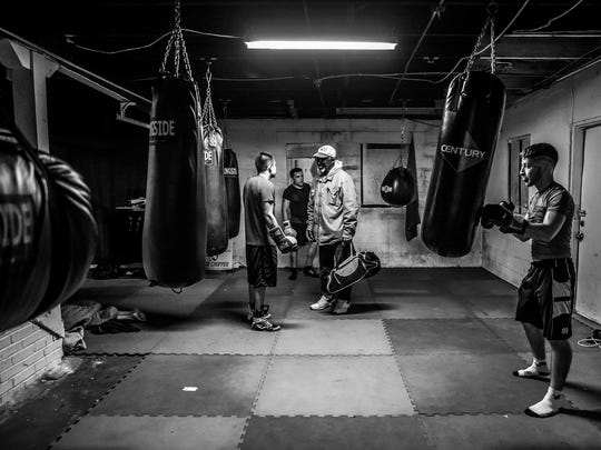 Sugar Ray Seales introduces himself to new students at Indy Boxing and Grappling before leaving the Eastside gym on Wednesday, April 4, 2018. Because he is legally blind, Seales must get a ride to and from the gym.
