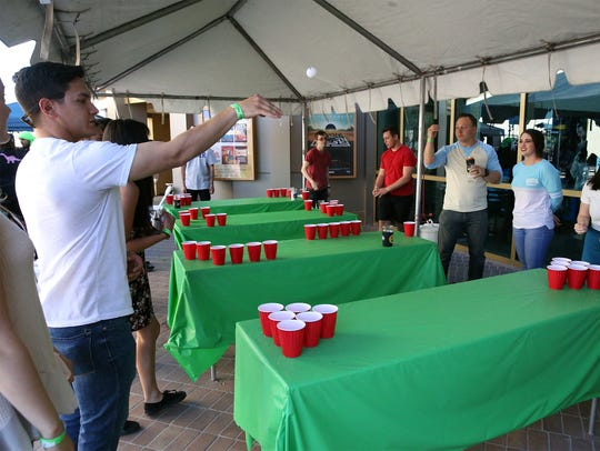 Patrons played beer pong last year at the Sun City Craft Beer Festival.