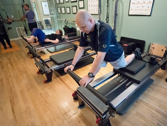 Troy Dellorfano works out at the Pilates Center of