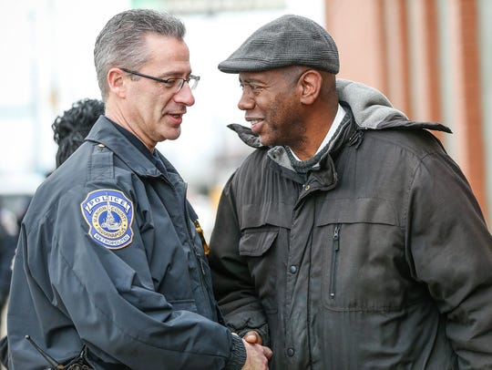 IMPD Chief Bryan Roach and the Rev. Charles Harrison