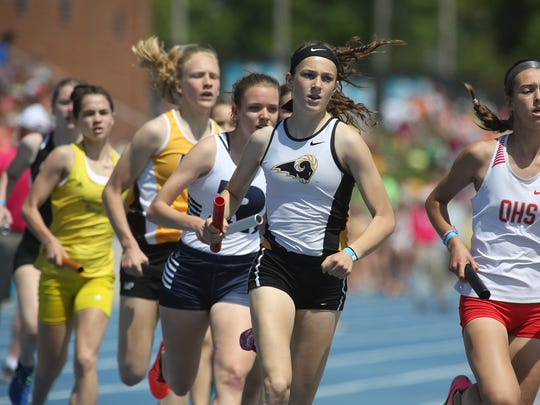 Southeast Polk sophomore Tarryn Hills breaks from the starting line in the Class 4A 4x800-meter relay at the 2018 state track meet held at Drake Stadium. The team finished third overall.