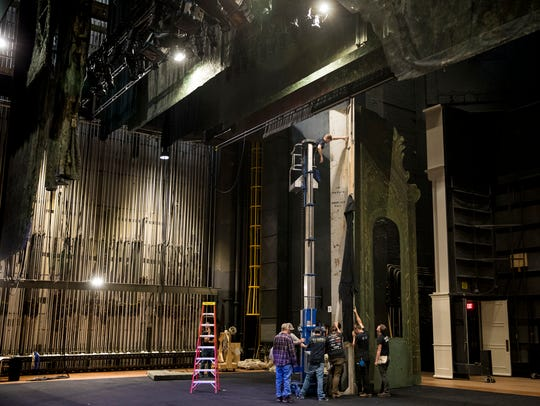 The Cincinnati Opera stage crew assembles scenery for