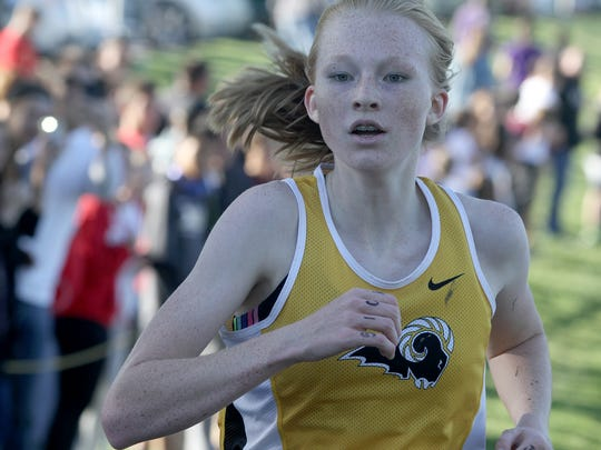 Southeast Polk sophomore Mattison Plummer leads in the state qualifying race. Indianola High School hosted a Class 4A cross country state qualifier at Pickard Park on Oct. 18.