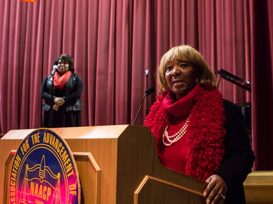 Gloria Sweet-Love delivers an address Monday evening