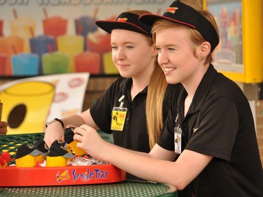 "Twins Megan Whitfield (left) and Katie Whitfield, crew members of Sonic Drive-In at Monroe Highway in Pineville, are on the ""Who Dat Tots"" team competing in Kansas City for the Dr. Pepper Sonic Games."