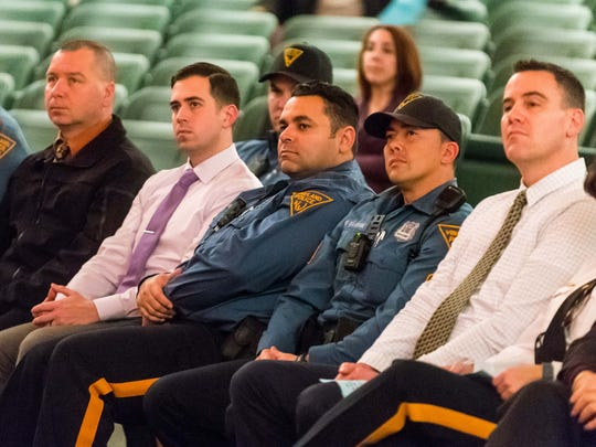 Vineland police officers watch during Vineland High School's Search for Conscience Tribute to the Police on Tuesday, December 6 at Vineland High.