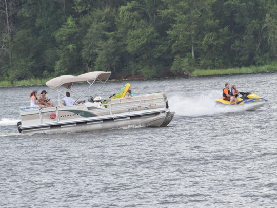 People flocked to the Indian Creek Recreation Area in Woodworth on Saturday to spend the holiday boating and playing on various watercrafts.