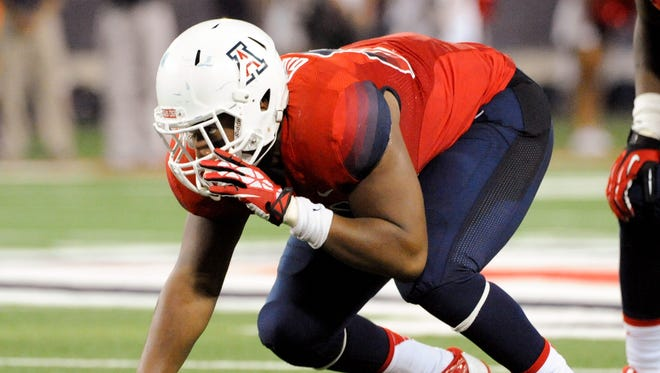 Sep 14, 2013: Arizona Wildcats defensive lineman Reggie Gilbert (84) lines up for a play during the second quarter against the Texas-San Antonio Roadrunners at Arizona Stadium. The Wildcats defeated the Roadrunners 38-13.