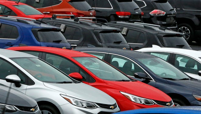 File photo from January  shows Chevrolet cars on a dealer lot in Pittsburgh. Across dealer lots in America, inventory is piling up as automakers produce more cars than are being bought.