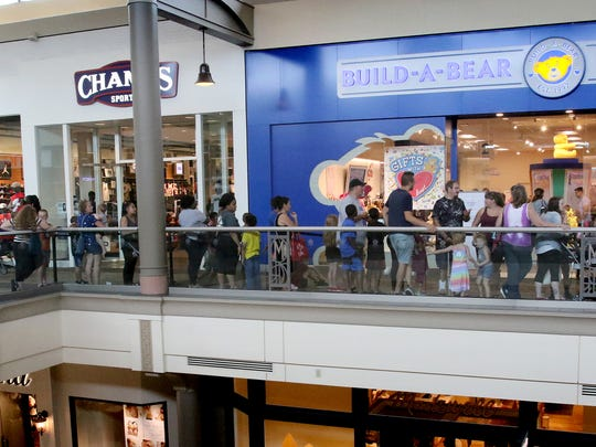 There were long lines at Mayfair Mall as people waited to enter Build-a-Bear for the pay-your-age promotion on July 12, 2018. The store changed things up for 2019 by having a raffle and staggered windows to buy the bears.