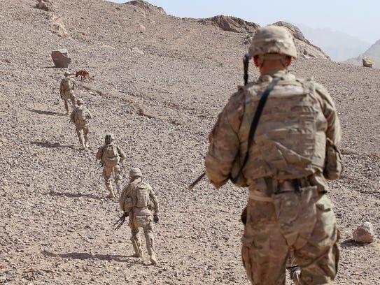 U.S. Army soldiers patrol near Kandahar, Afghanistan,