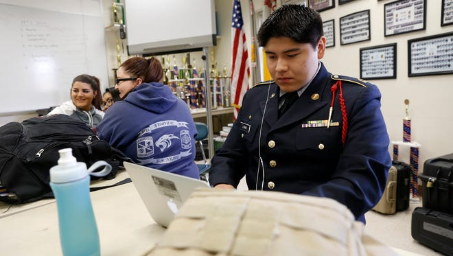 JROTC student Devin Lewis works on a history project  Wednesday during class at Piedra Vista High School in Farmington.