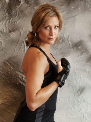 Marsha Smrcka poses during a workout.