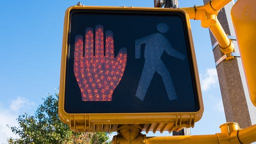 A stock image of a pedestrian stop light.