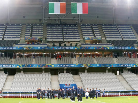 Italy players attend a walk around session at the Pierre Mauroy stadium in Villeneuve d'Ascq, near Lille, France, Tuesday, June 21, 2016. Italy will face Ireland in a Euro 2016 Group E soccer match in Lille on Wednesday, June 22, 2016. (AP Photo/Antonio Calanni)