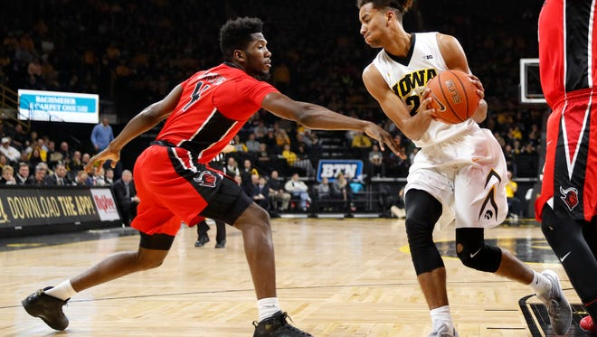 Iowa forward Dom Uhl, right, grabs a rebound in front of Rutgers forward Jonathan Laurent.