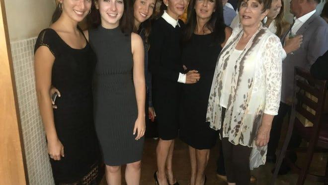 Lisa Cooperman in the middle between her sister Deborah Rosenberg and mother, Claudette DiMare.