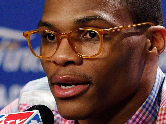 FILE - In this June 17, 2012, file photo, Oklahoma City Thunder point guard Russell Westbrook, sporting eyewear, listens to a question during a news conference after Game 3 of the NBA finals basketball series in Miami. Westbrook Frames, a company that Thunder All-Star guard Russell Westbrook co-owns, has partnered with the NBA to launch a new series of eyewear.  (AP Photo/Wilfredo Lee, File)