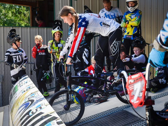 Olympic BMX racing silver medalist Alise (Post) Willoughby takes riders through starts at the gate during a clinic Tuesday, July 17, at the Pineview Park BMX track. Willoughby and her husband Sam, Australian Olympic silver medalist in BMX racing, worked with riders during an afternoon clinic.